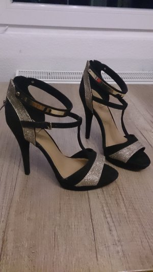 High Heels in schwarz-gold