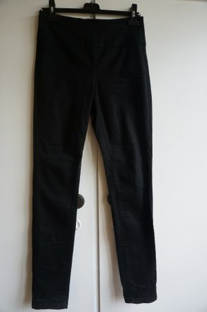 High Waist Hose mit auffälligem rückwärtigem Zipper