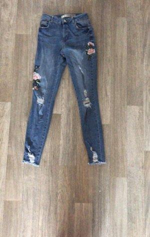High waist Jeans destroyed mit Blumen