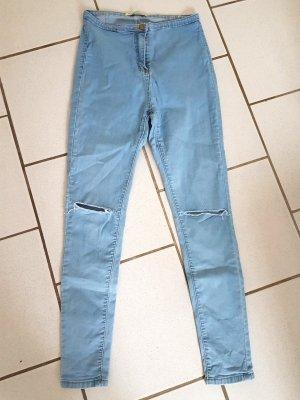 High Waist Jeans mit Rissen