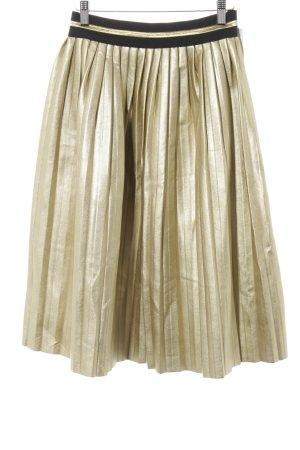 Falda de talle alto color oro-negro estampado a rayas look casual