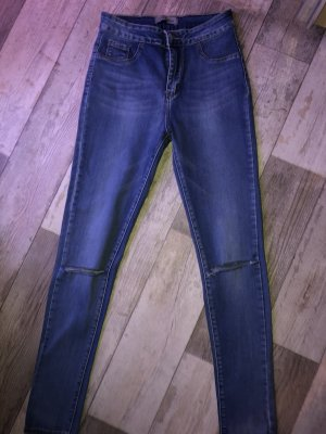 High Waist Skinny Jeans mit Rissen am Knie