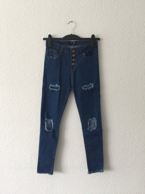 High-waisted destroyed Jeans S