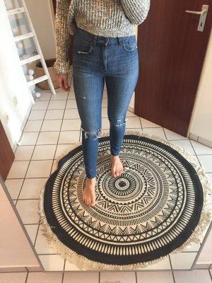 High warst Jeans mit Schlitzen