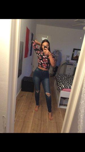 Highwaist Jeans mit Löchern