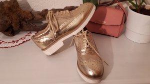 Claudia Ghazzani Zapatos estilo Oxford color oro