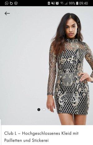 hochgeschlossenes Kleid mit pailetten und stickereien