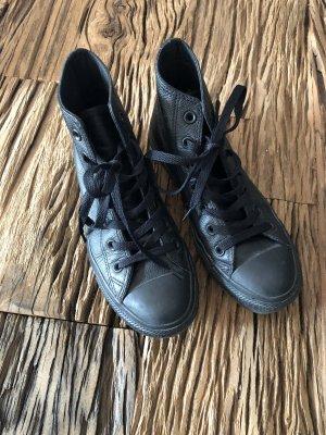 Hohe Converse All Stars in schwarz / Leder
