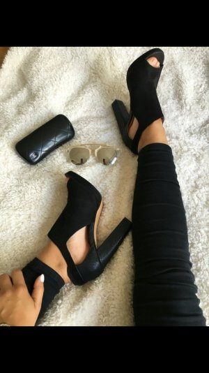 Hohe Schuhe schwarz Gold