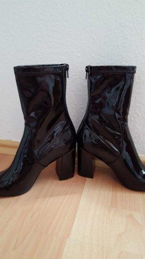 hohe schwarze lack boots
