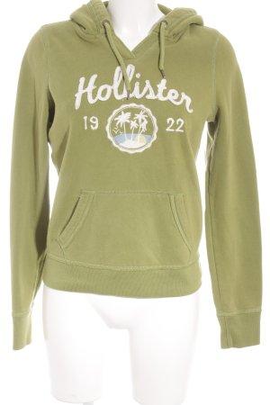 Hollister Kapuzensweatshirt grasgrün-weiß Schriftzug gestickt sportlicher Stil