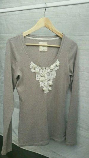 Hollister Langarmshirt Pullover Rüschen Spitze V-Ausschnitt beige nude Größe L