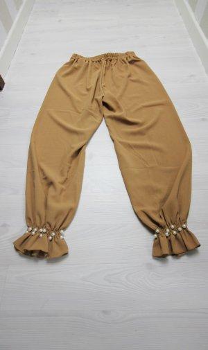 Pantalón tobillero marrón arena-blanco