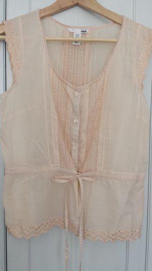 Hübsche blassrosa Bluse mit zarter Stickerei von H&M
