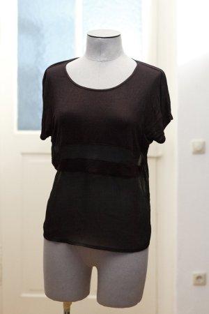 hübsches, schwarzes T-Shirt mit transparentem Unterteil