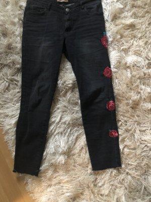 Pantalone a vita bassa nero-rosa