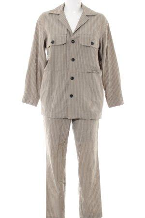 Tailleur pantalone bianco sporco motivo a righe stile professionale