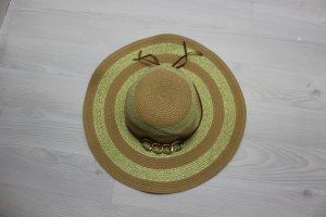 Hat sand brown-gold-colored
