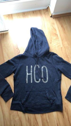 Ich verkaufe einen Pullover in dunkelblau mit Pailletten von Hollister in M