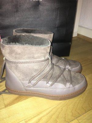 Inuikii Schuhe
