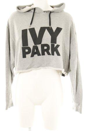 Ivy Park Jersey con capucha gris estampado temático look casual