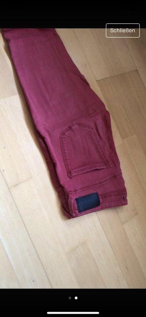 Pantalone a vita bassa rosso