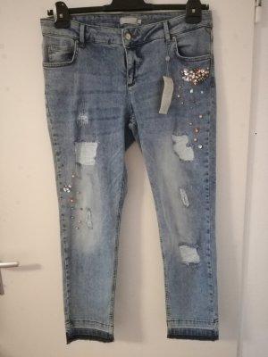 Jeans im Usedlook mit Strass