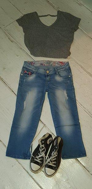 Jeans a 3/4 rosso-azzurro