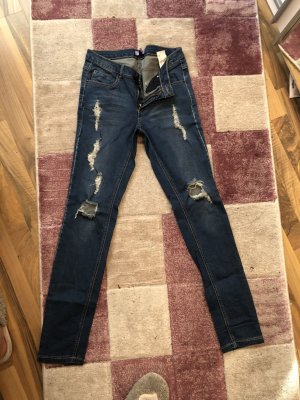 Jeans mit Löcher