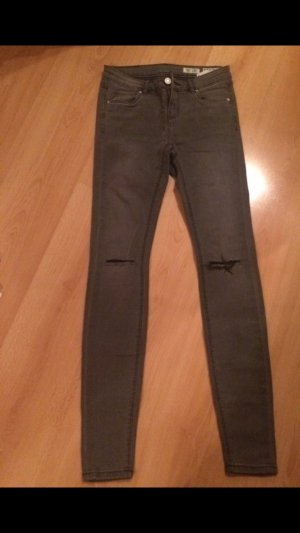 Jeans mit Löchern in den Knien