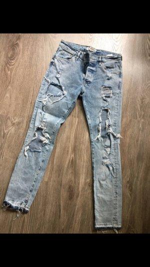 Jeans mit Löchern von H & M