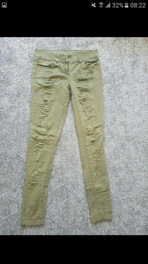Jeans mit offenen Rissen