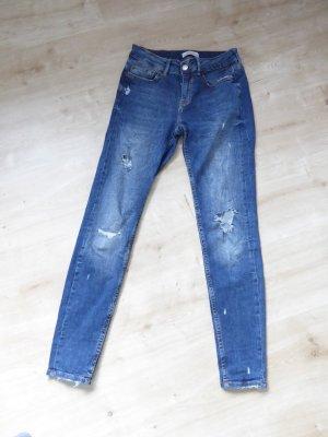 Jeans mit Rissen