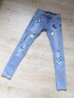 Jeans mit Schmetterlingen und Blumen Größe S