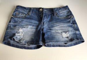 Madonna Pantalón corto de tela vaquera azul