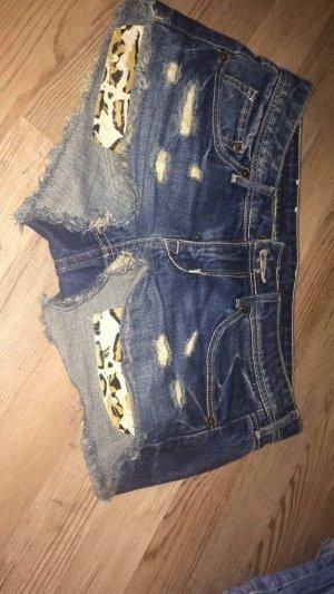 Jeans - Shorts mit Leopardentaschen