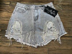 Shorts color plata