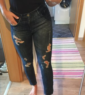 Jeans used look zerrissen , ripped
