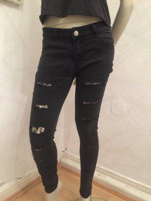 Jeans zerrissen mit Netzunterlage Gr.28