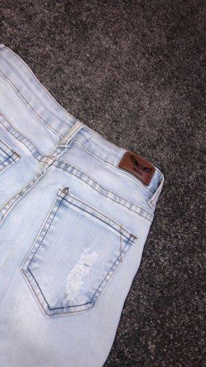 Jeans a vita alta celeste
