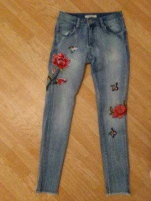 Pantalón tobillero azul-rojo
