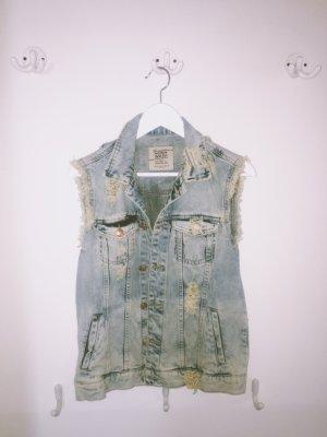 Jeansjacke ohne Ärmel im Destroyed Vintagestyle