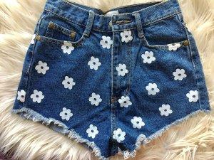 Jeansshorts • mit aufgedruckten Blumen • S