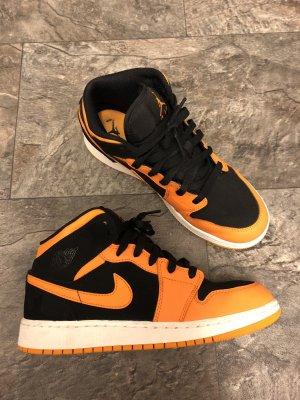 Jordan 1 mid schwarz orange