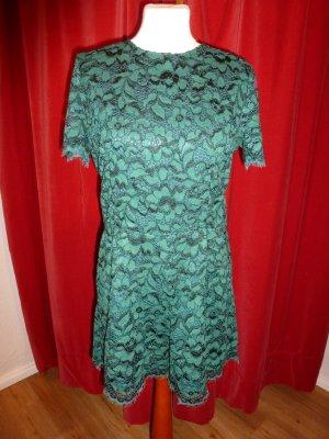 Jumpsuit, kurz, aus dunkelgrüner Spitze von Zara, Gr. M/L - wie neu