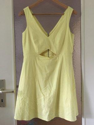 Jumpsuit / Minikleid in gelb mit Cutout und Reisverschluss