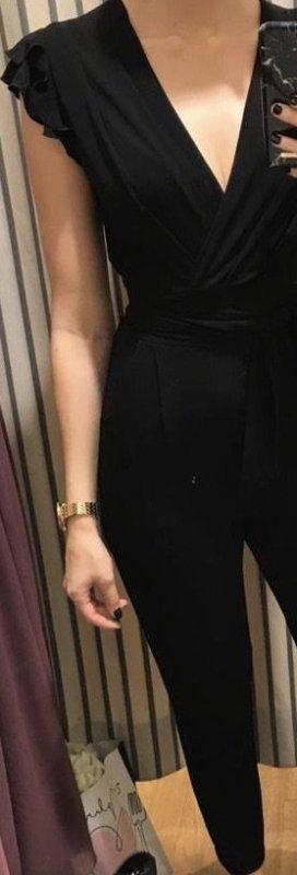 Jumpsuit schwarz mit Wickeldetail