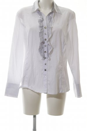 Just White Blusa con volantes blanco look casual