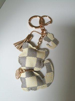 Porte-clés blanc-doré faux cuir