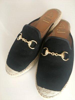 Kanna Zuecos negro-color oro Cuero